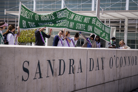 Supporters of the Equal Rights Amendment march to the state Capitol on March 13, 2019, in downtown Phoenix.