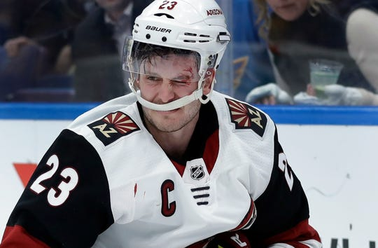 Arizona Coyotes' Oliver Ekman-Larsson, of Sweden, picks himself up off the ice after slamming into the boards while chasing a loose puck during the second period of an NHL hockey game against the St. Louis Blues, Tuesday, March 12, 2019, in St. Louis.