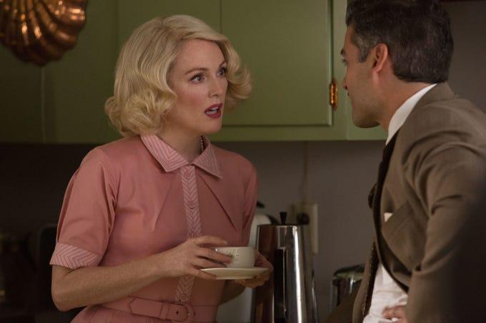 "Roger (Oscar Isaac) interrogates Maggie (Julianne Moore) in ""Suburbicon."""