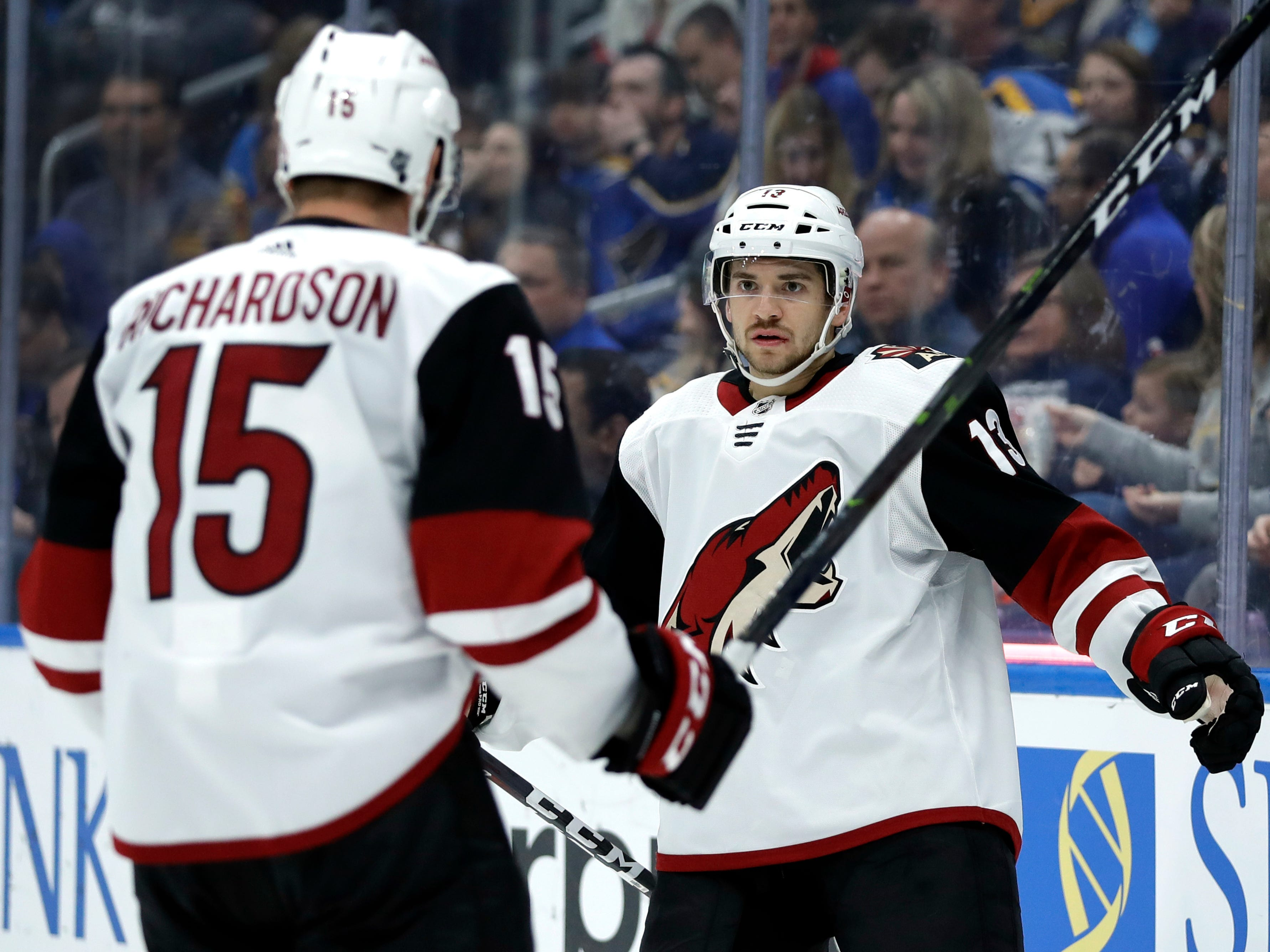 Arizona Coyotes' Vinnie Hinostroza, right, is congratulated by Brad Richardson after scoring during the third period of an NHL hockey game against the St. Louis Blues, Tuesday, March 12, 2019, in St. Louis. The Coyotes won 3-1.