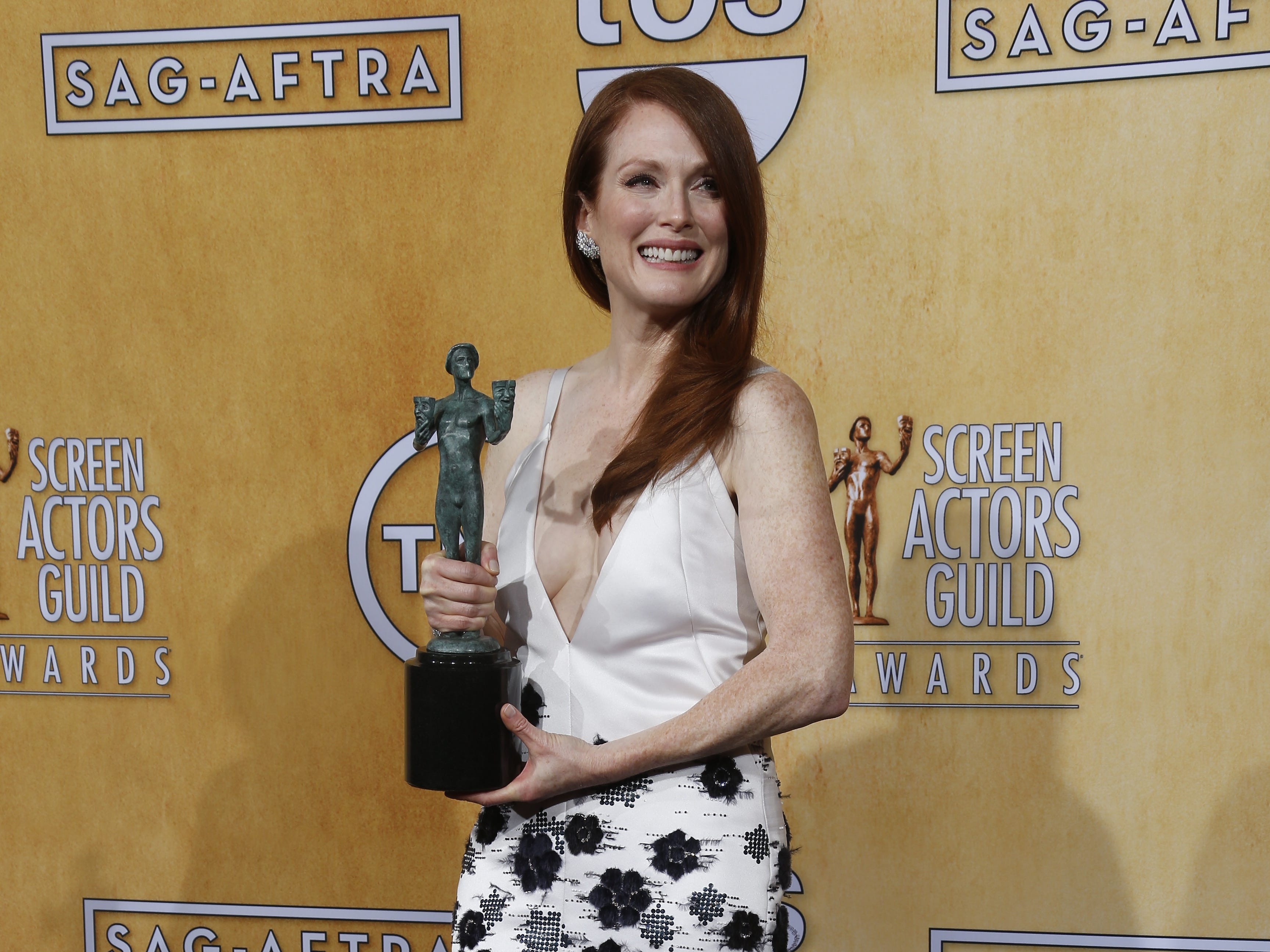 Julianne Moore, winner Outstanding Performance by a Female Actor in a Television Movie or Miniseries, poses in the photo room at the Screen Actors Guild awards at the Shrine Auditorium in Los Angeles.