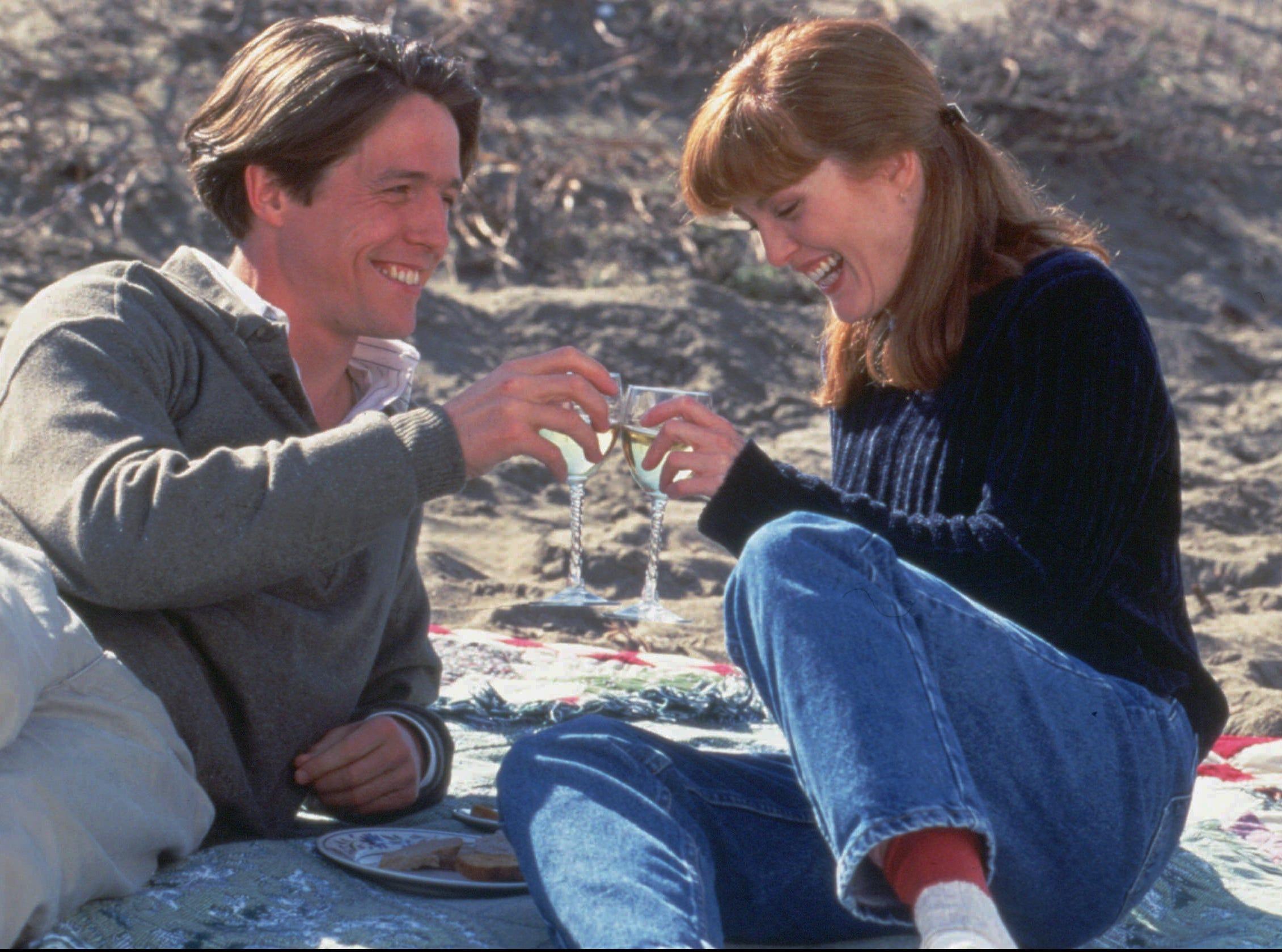 "Hugh Grant and Julianne Moore in ""Nine Months."""