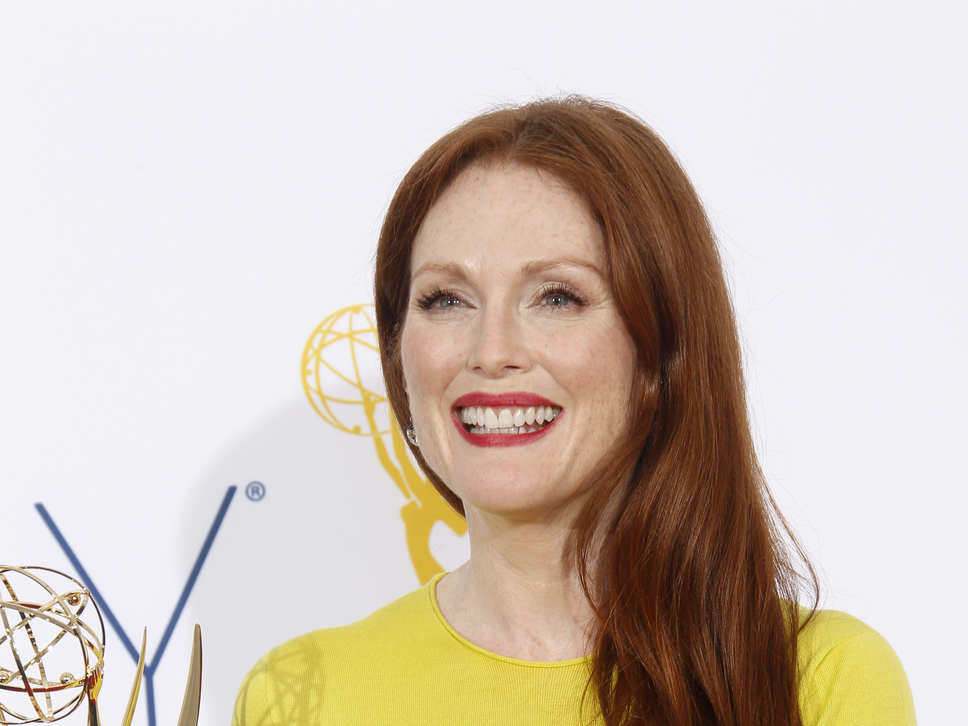 Outstanding Lead Actress in a Miniseries or Movie winner Julianne Moore poses in the photo room at the 2012 Emmy Awards at the Nokia Theatre in Los Angeles.
