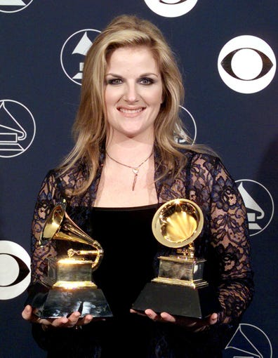 Trisha Yearwood holds her two Grammy Awards February, 25, 1998, in New York. Yearwood won for Best Female Country Vocal Performance and Best Country Collaboration with Vocals.