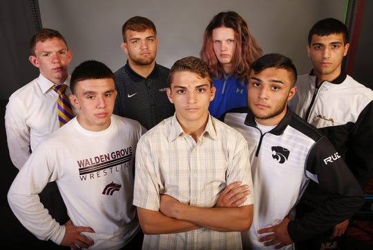 azcentral's All-Arizona wrestling team (from back left) Steven Jarman, Mesa High, Tarik Sutkovic, Ironwood High, Jeremiah Hollen, Mesa Mountain View, Jake Borneman, Arizona Lutheran Academy, (from front left) Diego Guerrero, Walden Grove, Andres Avelor, Cesar Chavez High and Marcus Castillo, Maran Mountain View photographed in Phoenix, Ariz. March 6, 2019.