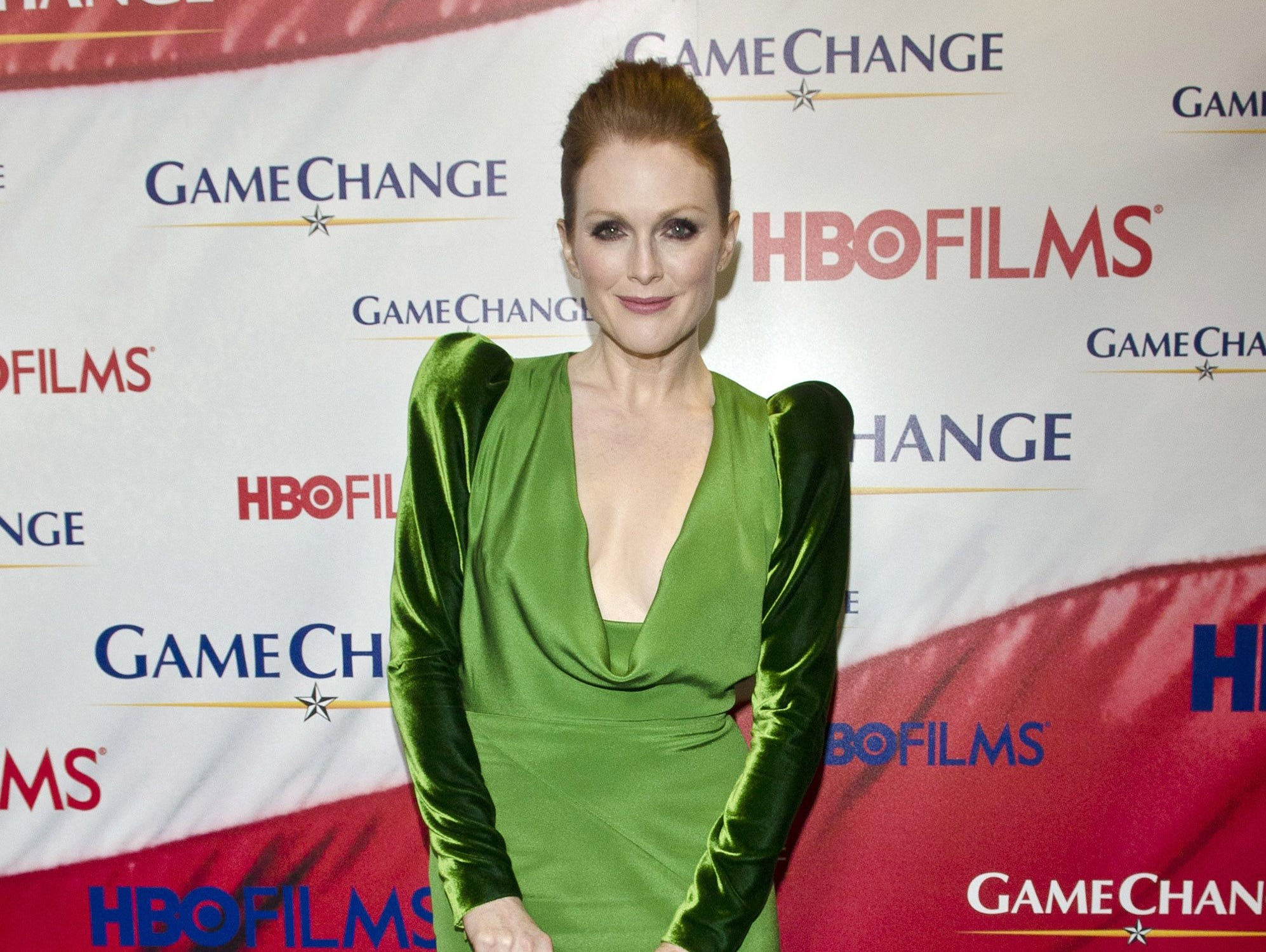"""Julianne Moore poses on the red carpet, wearing Tom Ford during the """"Game Change"""" premiere at The Newseum on March 8, 2012, in Washington, DC."""