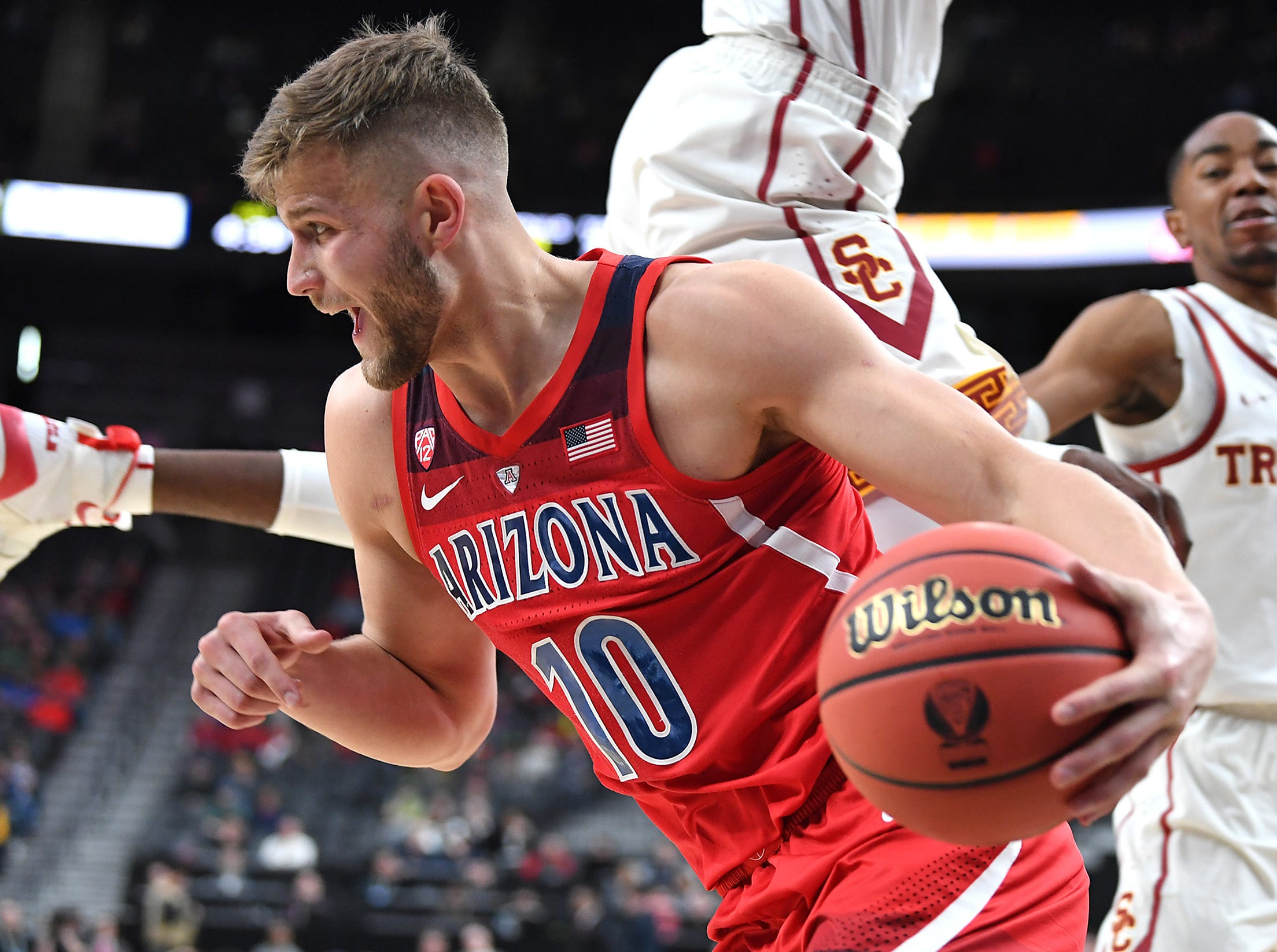 Mar 13, 2019; Las Vegas, NV, United States; Arizona Wildcats forward Ryan Luther (10) dribbles during the first half against the USC Trojans in a Pac-12 conference tournament game at T-Mobile Arena. Mandatory Credit: Stephen R. Sylvanie-USA TODAY Sports