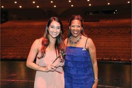 Krystina Alabado (left) received the Rising Star Award from ASU Gammage executive director Colleen Jennings-Roggensack in 2017.