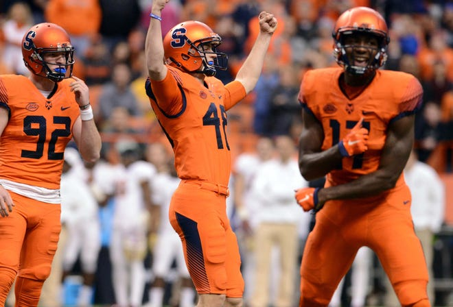 Syracuse kicker Cole Murphy (48) celebrates after hitting a game-winning field goal against Boston College.