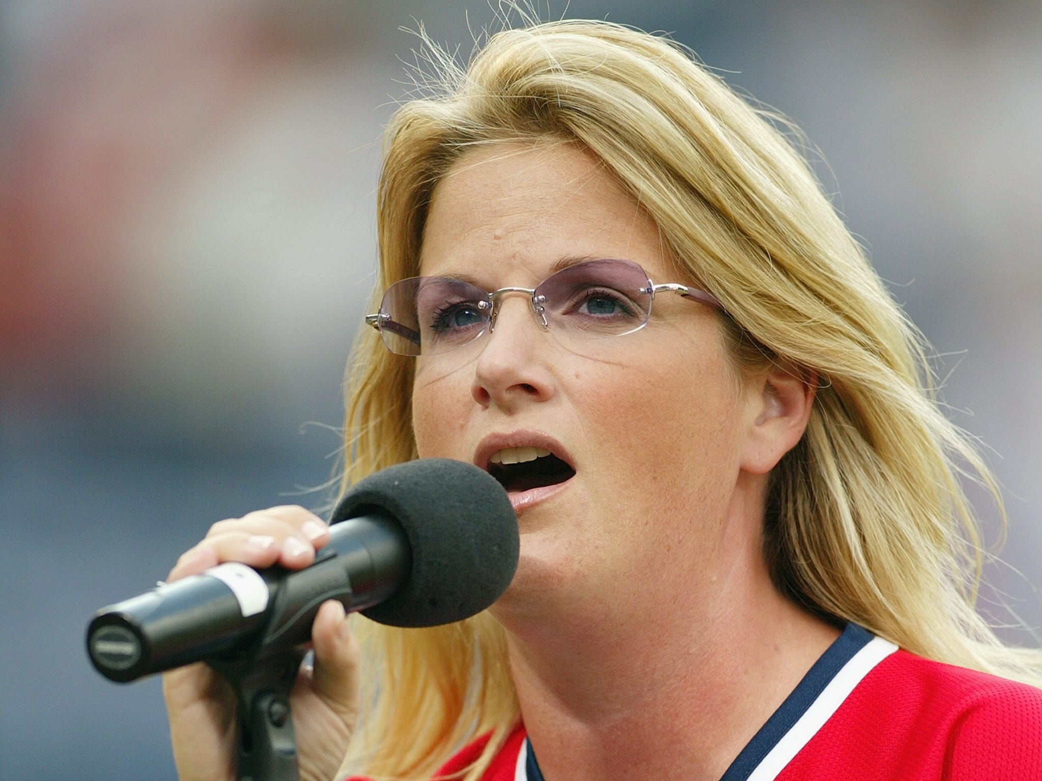 Trisha Yearwood sings the National Anthem prior to the start of the game between the Florida Marlins and the Atlanta Braves on July 23, 2003 at Turner Field in Atlanta, Georgia.