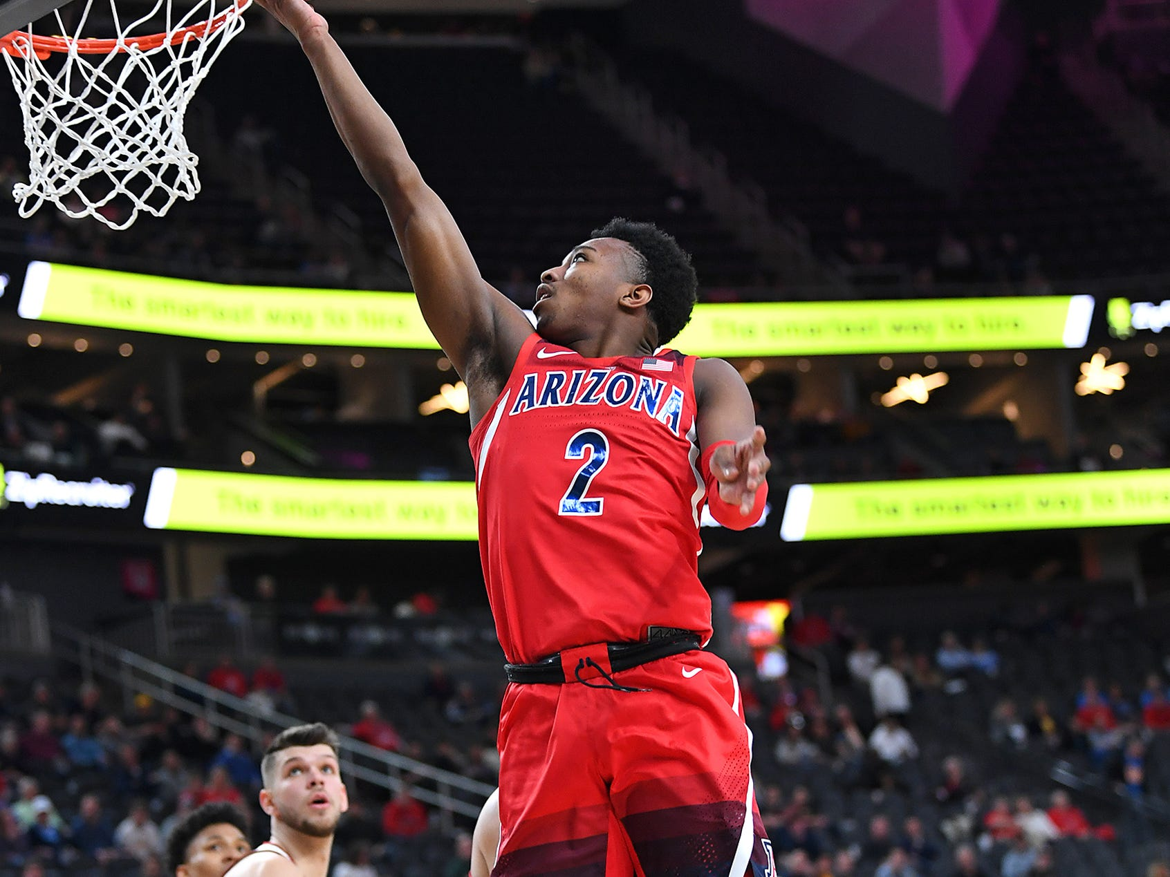 Mar 13, 2019; Las Vegas, NV, United States; Arizona Wildcats guard Brandon Williams (2) shoots during the first half against the USC Trojans in a Pac-12 conference tournament game at T-Mobile Arena. Mandatory Credit: Stephen R. Sylvanie-USA TODAY Sports