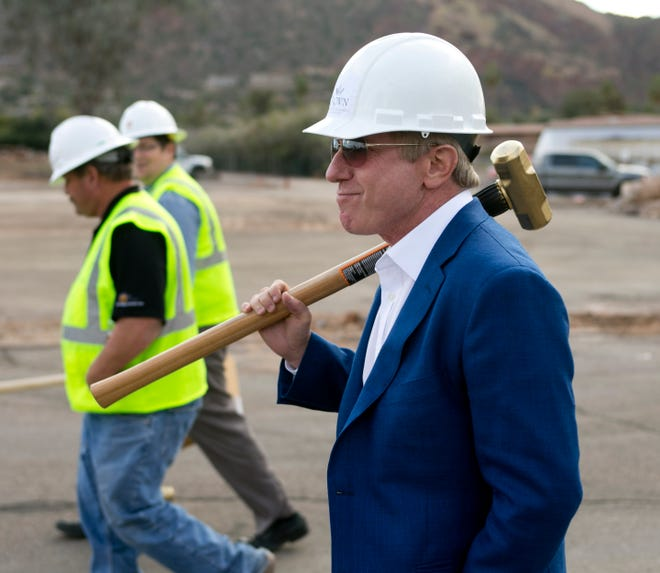 Crown Realty and Development CEO Robert Flaxman walks to the demolition site of the  Mountain Shadows resort in Paradise Valley, Feb. 5, 2014.