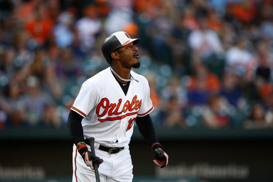 Baltimore Orioles' Adam Jones flies out during a baseball game against the Houston Astros, Sunday, Sept. 30, 2018, in Baltimore.