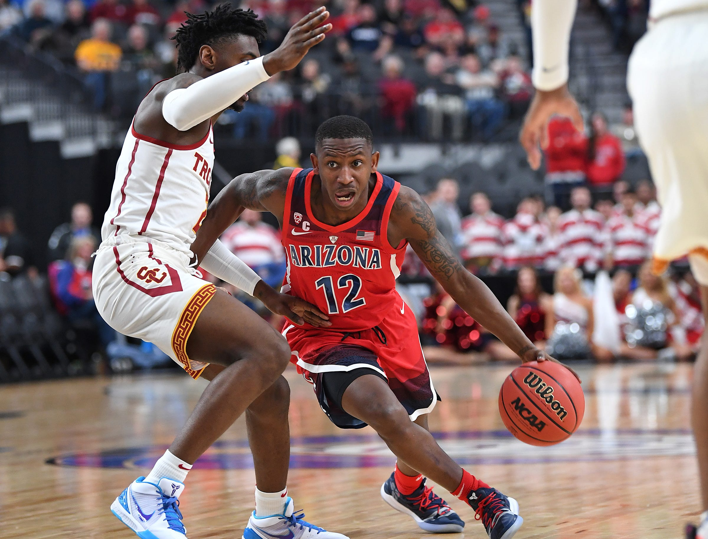Mar 13, 2019; Las Vegas, NV, United States; Arizona Wildcats guard Justin Coleman (12) dribbles during the first half against the USC Trojans in a Pac-12 conference tournament game at T-Mobile Arena. Mandatory Credit: Stephen R. Sylvanie-USA TODAY Sports
