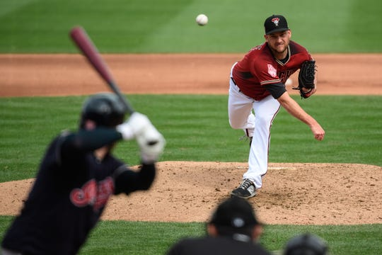 Matt Andriese #35 of the Arizona Diamondbacks delivers a pitch during the spring training game against the Cleveland Indians at Salt River Fields at Talking Stick on March 07, 2019 in Scottsdale, Arizona.