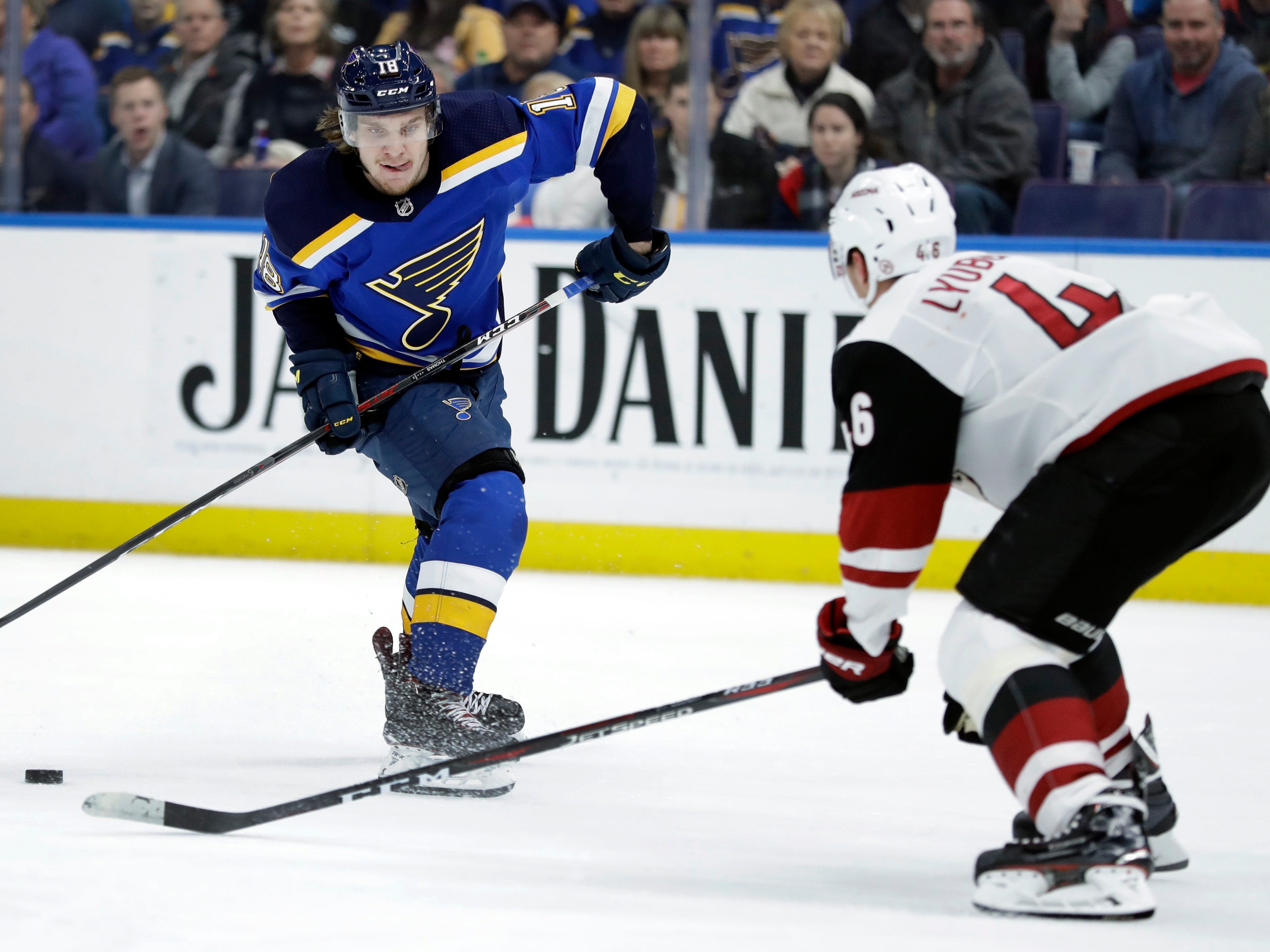 St. Louis Blues' Robert Thomas, left, looks to shoot past Arizona Coyotes' Ilya Lyubushkin, of Russia, during the second period of an NHL hockey game, Tuesday, March 12, 2019, in St. Louis.