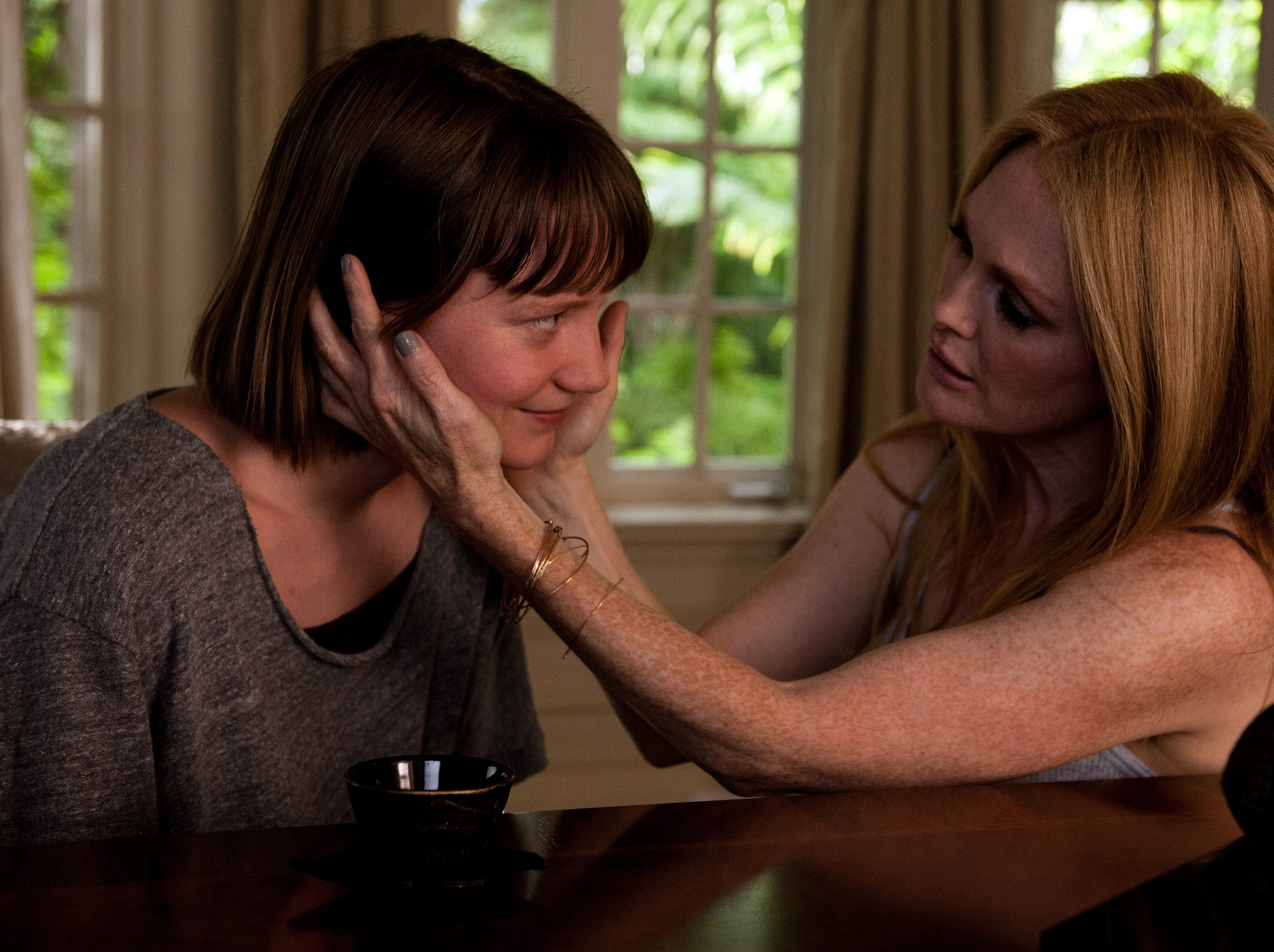 """Mia Wasikowska and Julianne Moore in a scene from the motion  picture """"Maps to the Stars."""""""