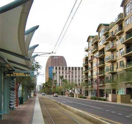 The palm trees planted along Central Avenue in downtown Phoenix have been replanted as the road has been widened due to the installation of the Light Rail.