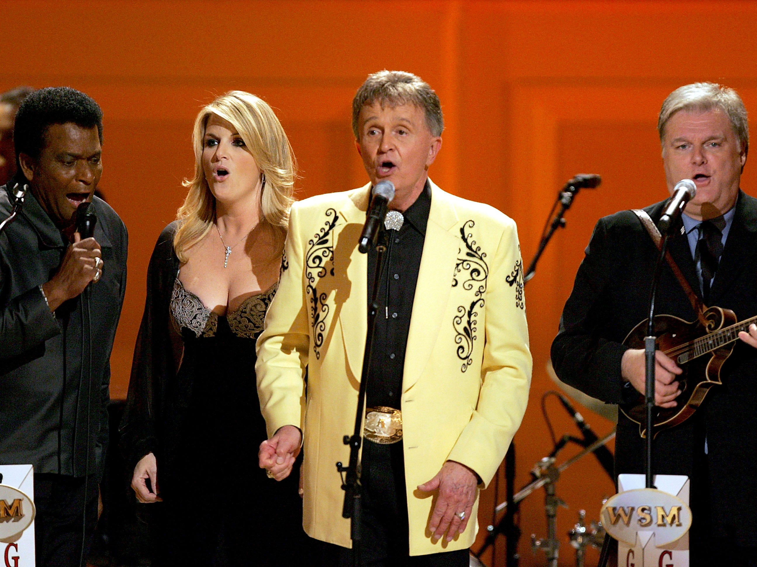 """Charley Pride, Trisha Yearwood, Bill Anderson and Ricky Skaggs perform during a taping of the """"Grand Ole Opry"""" at Carnegie Hall November 14, 2005 in New York City."""