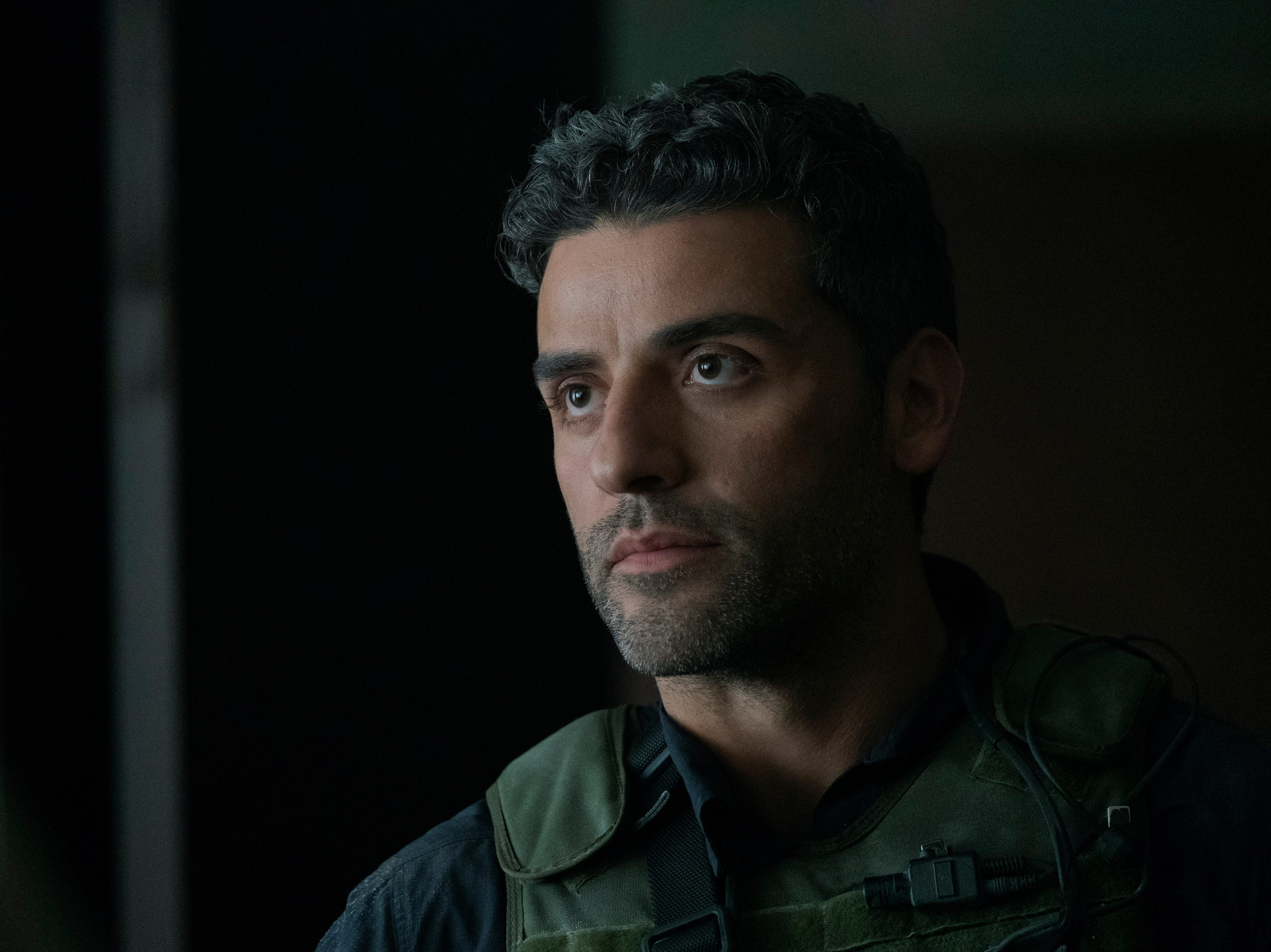 """Oscar Isaac stars in """"Triple Frontier."""" From the review: """"It's a movie that maybe tries to do too much, but it does enough of it well to keep you glued to the screen."""" (4 stars)"""