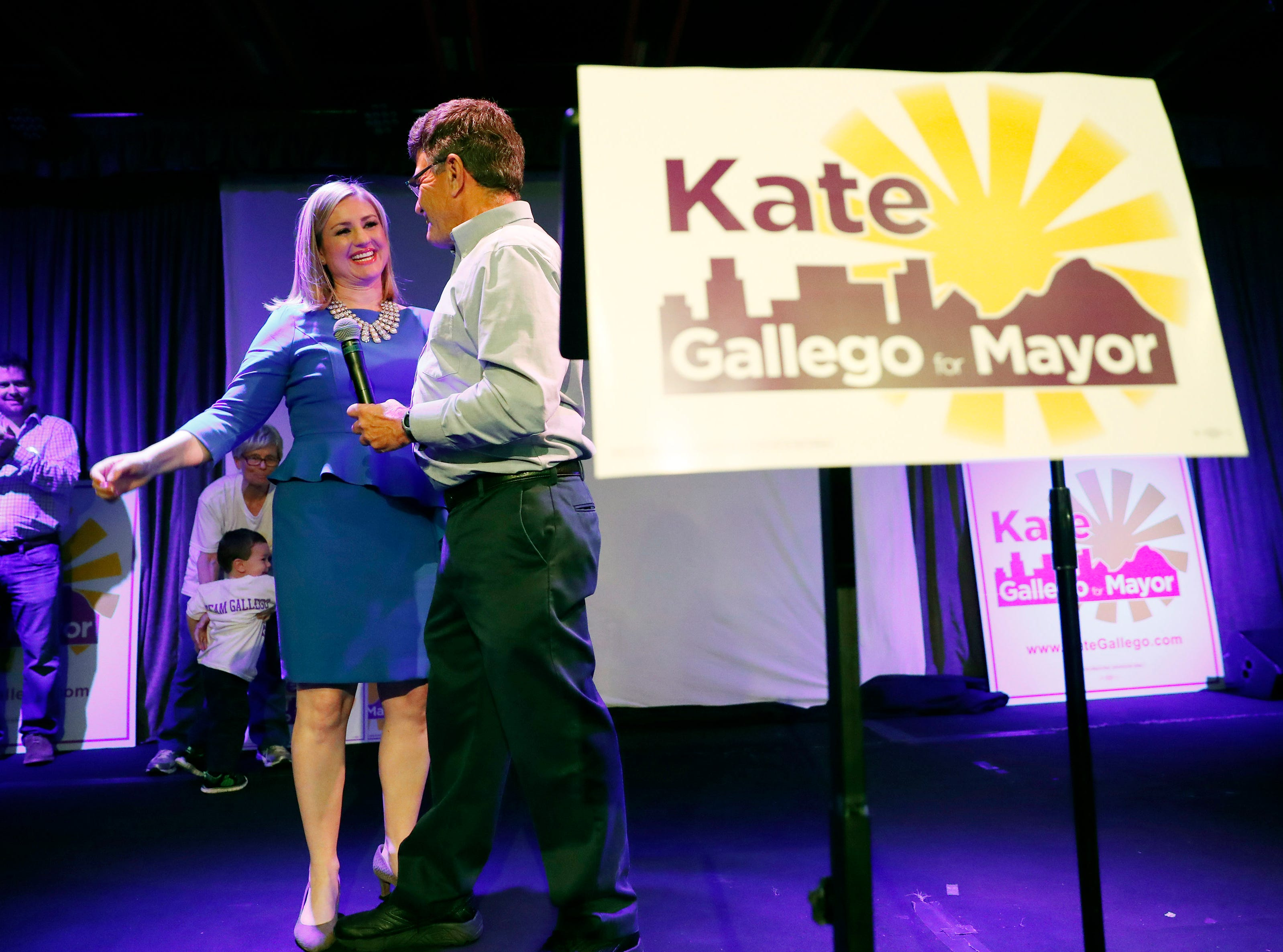 Democrat Kate Gallego hugs her father, Jim Widland, at an election-night party at Crescent Ballroom in Phoenix on March 12, 2019.