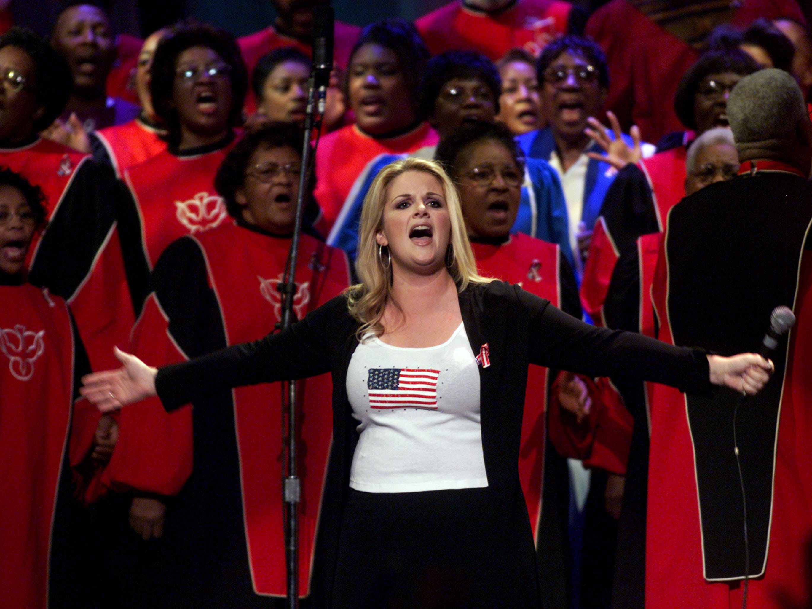 """Trisha Yearwood performs """"We Shall Be Free"""" with a choir at the Country Freedom Concert October 21, 2001 at Nashville's Gaylord Entertainment Center."""