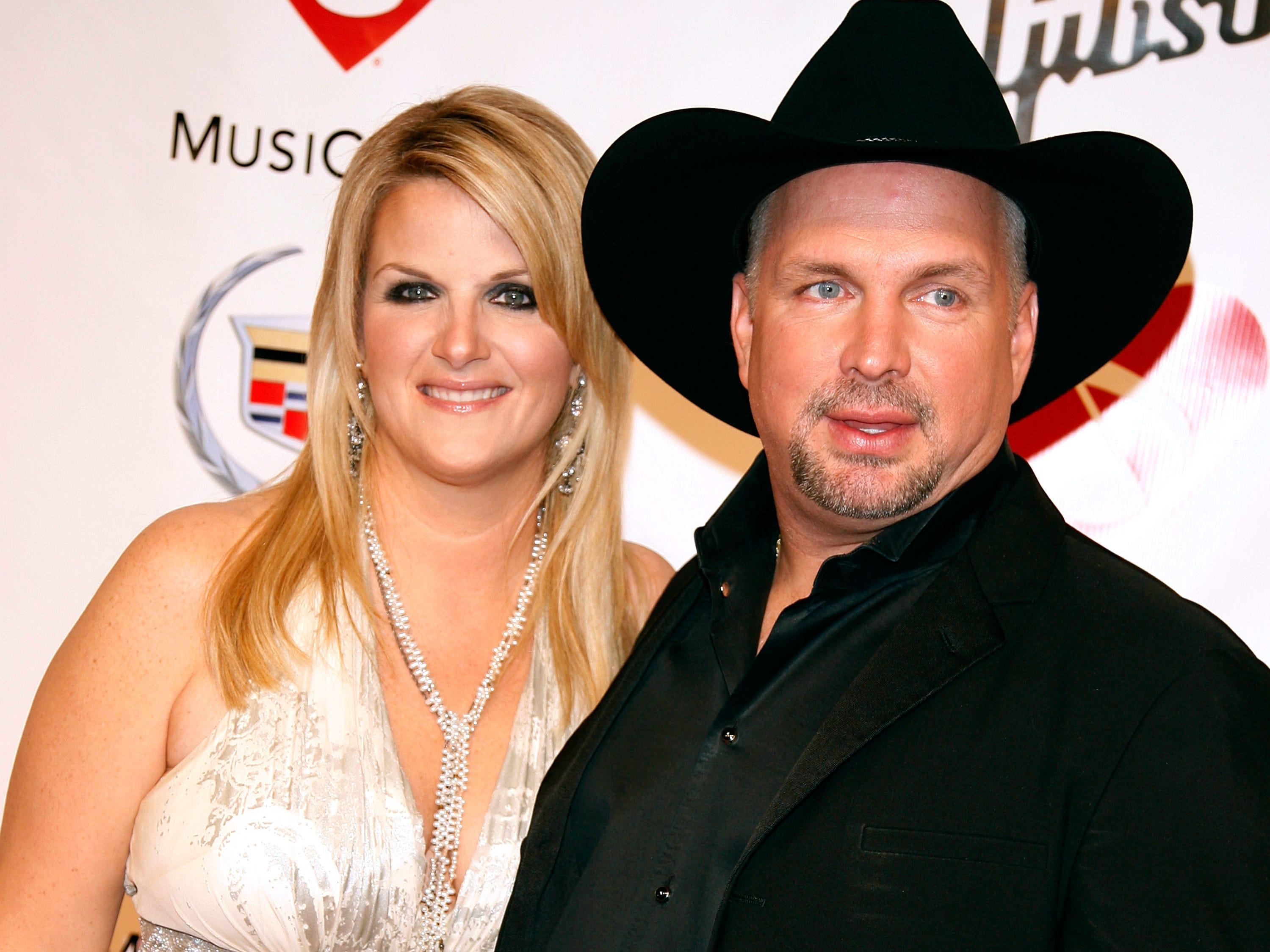 Trisha Yearwood and Garth Brooks arrive at the 2007 MusiCares Person of the Year honoring Don Henley at the Los Angeles Convention Center on February 9, 2007 in Los Angeles, California.