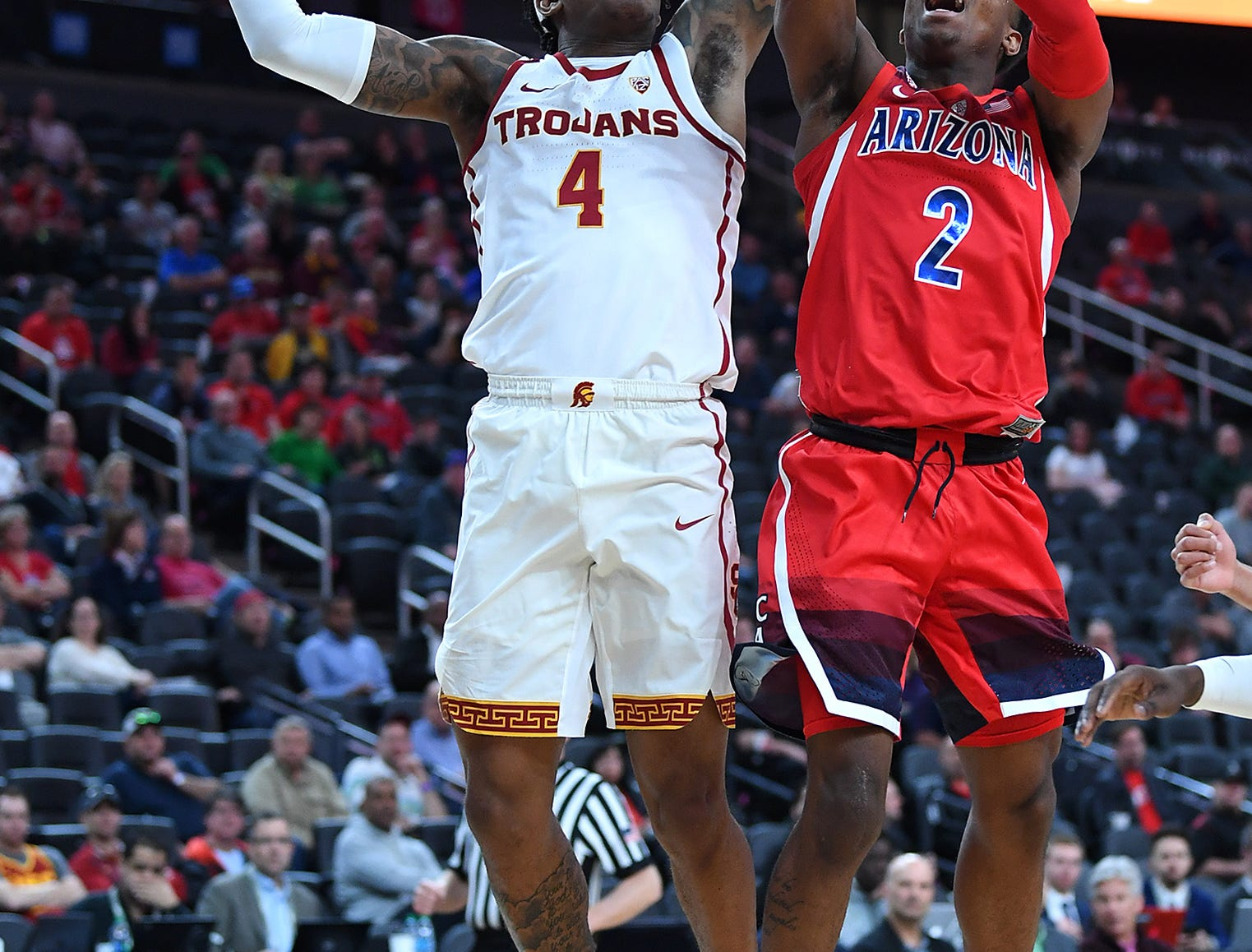 Mar 13, 2019; Las Vegas, NV, United States; USC Trojans guard Kevin Porter Jr. (4) blocks a shot by Arizona Wildcats guard Brandon Williams (2) during the first half of a Pac-12 conference tournament game at T-Mobile Arena. Mandatory Credit: Stephen R. Sylvanie-USA TODAY Sports