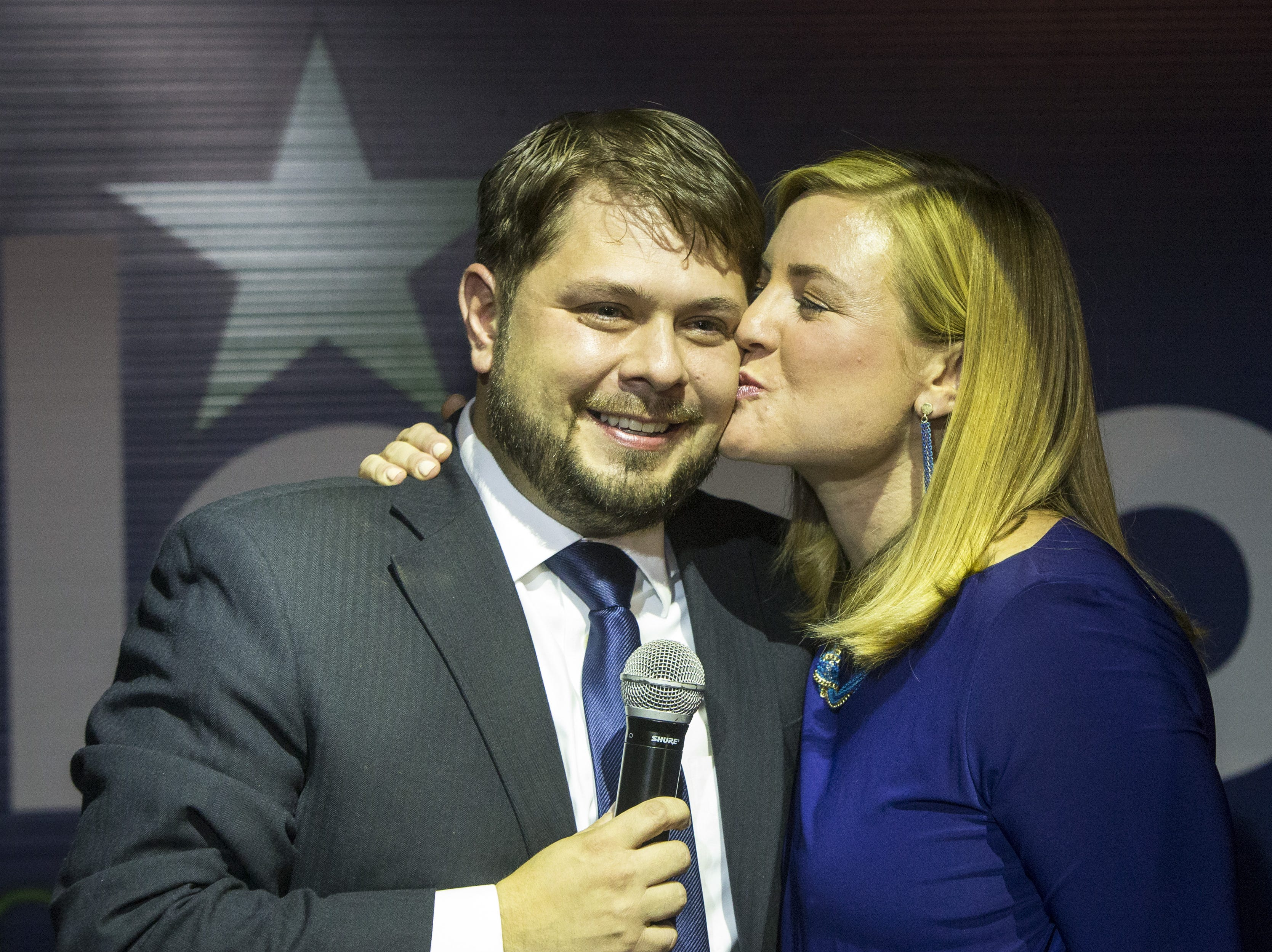 Charlie Leight/The Republic Democrat Ruben Gallego gets a congratulatory kiss from his wife, Phoenix City Councilwoman Kate Gallego, at his election-night victory party at Club Downtown in Phoenix. Gallego?s main rival, Mary Rose Wilcox, conceded shortly before 9 p.m. He would become the first Iraq War veteran to go to Congress from Arizona if he wins the general election in the overwhelmingly blue district. Democrat Ruben Gallego gets a congratulatory kiss from his wife, Phoenix City Council woman Kate Gallego, at his election night victory party at Club Downtown, in Phoenix, Tuesday, Aug. 26, 2014. Gallego is running in the primary against Mary Rose Wilcox, for the 7th District to replace retiring U.S. Rep. Ed Pastor.