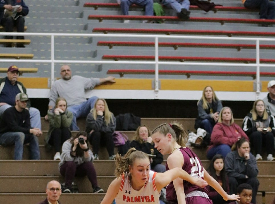 Palmyra's Zoe Smith drives past Wyoming Valley West's Jessica Shaver in a PIAA Class 5A girls' basketball second-round game on March 13, 2019.