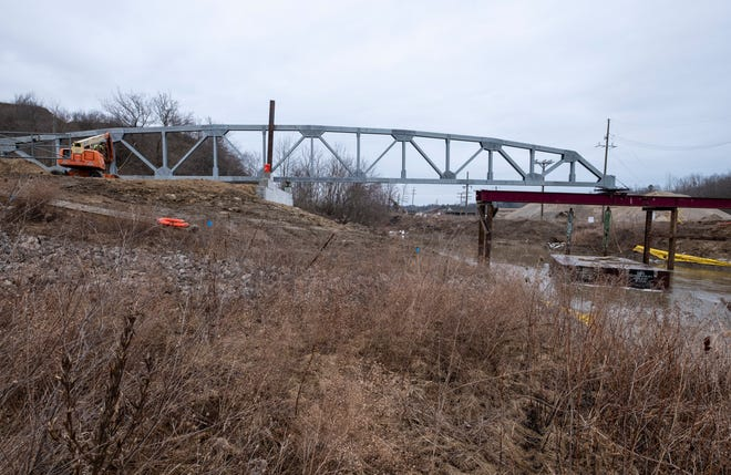 Crews work on completing construction on the first of two trusses being built as part of the reconstruction of the Fisher Road Bridge over the Black River Wednesday, March 13, 2019 in Grant Township. The project is expected to be completed in May.
