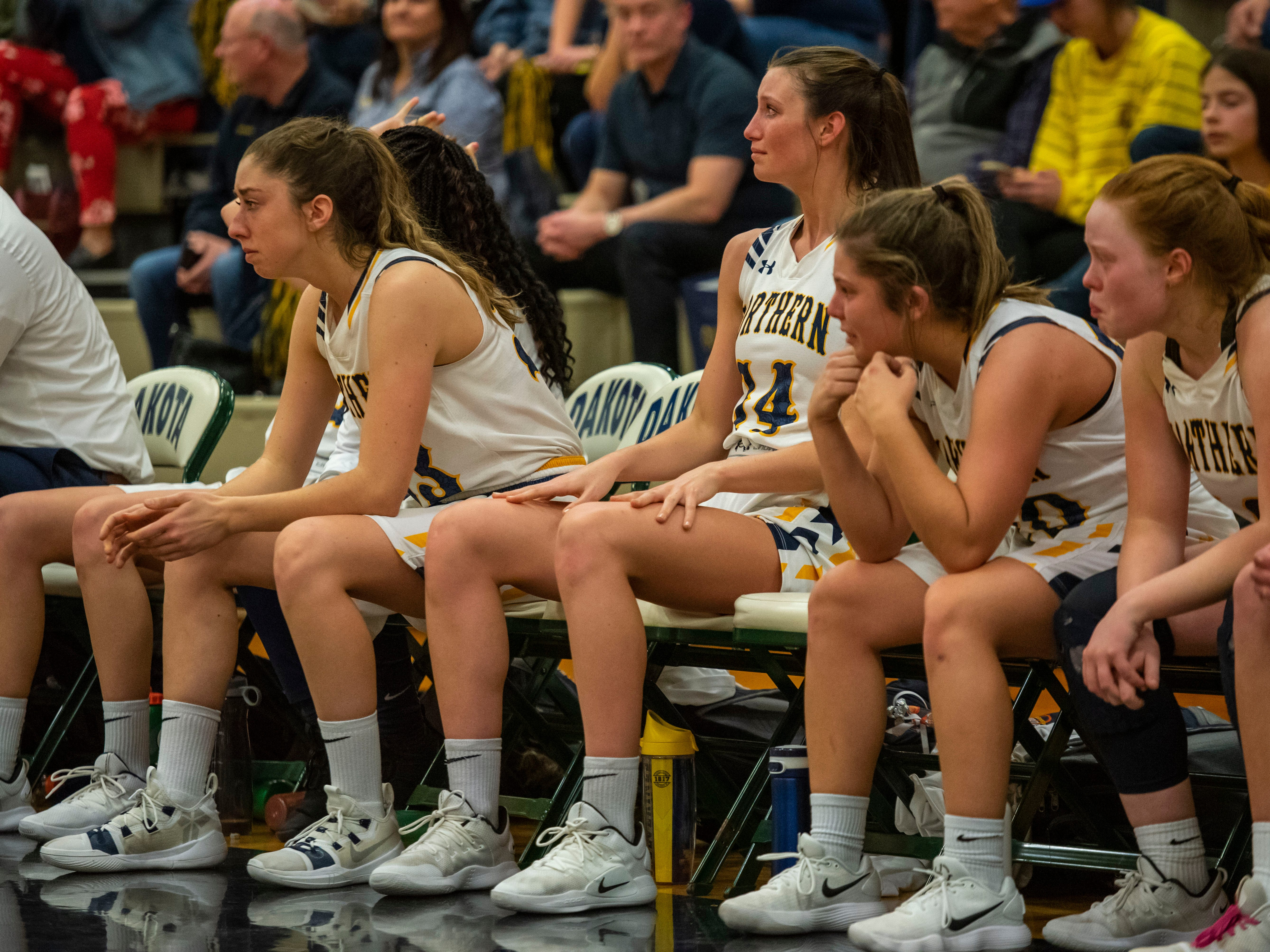 The Port Huron Northern High School girls basketball team get emotion watching the end of the MHSAA Division 1 Region 8 girls basketball finals against Lakeview High School Wednesday, March 13, 2019 at Macomb Dakota High School. Northern lost 37-46.