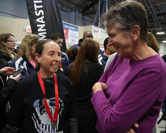 Special Olympics athlete Christina Gagliardo of Beekman speaks with volunteer Liz Sawicki after Wednesday's Special Olympics press conference  in the Town of Poughkeepsie on March 13 2019.  Sawicki is a guidance counselor at Titusville Middle School where Gagliardo was a student of hers.