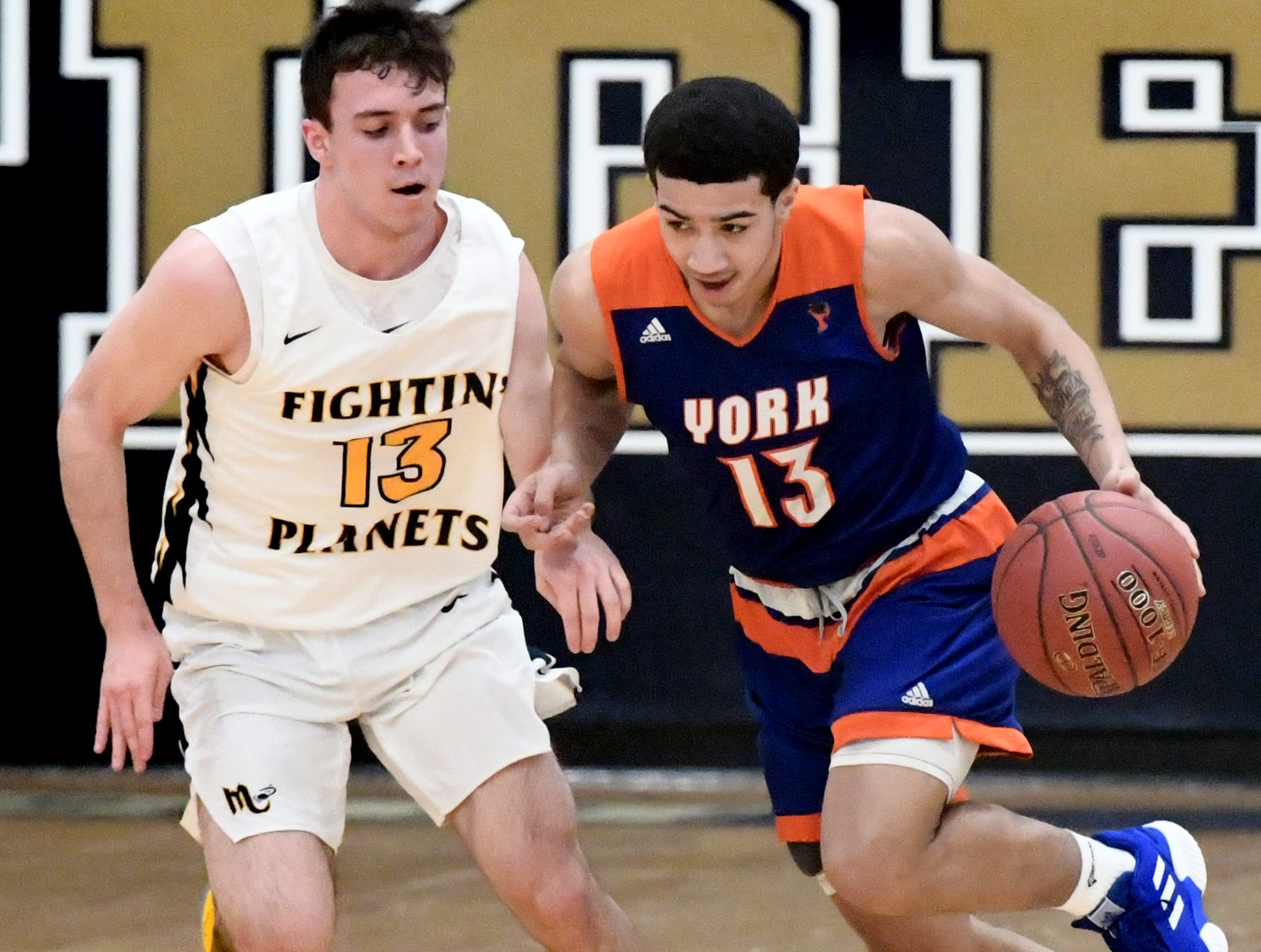 York High's Dayvon Cortez drives after stealing from Mars' Andrew Recchia during a PIAA Class 5-A second-round state boys' basketball playoff game at Holidaysburg High School in Blair County Tuesday, March 12, 2019. York lost the game 60-59. Bill Kalina photo