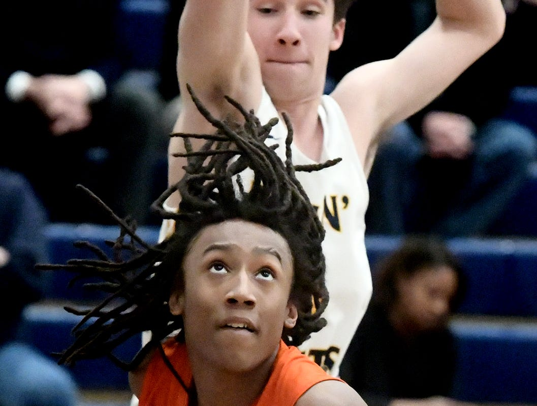 York High's Edward Minter looks to the hoop with Mars' Zach Schlegel defending during a PIAA Class 5-A second-round state boys' basketball playoff game at Holidaysburg High School in Blair County Tuesday, March 12, 2019. York lost 60-59. Bill Kalina photo