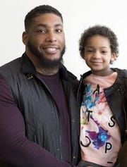 Devon Still is shown here with his daughter Leah when she was 5 years old. AP FILE PHOTO