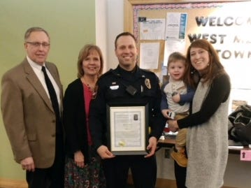 West Manchester Township Police Sgt. Adam Jordan stands with his family after he was recognized during the township supervisor meeting in February. He was one of four who were promoted. Photo courtesy of West Manchester Township Police.