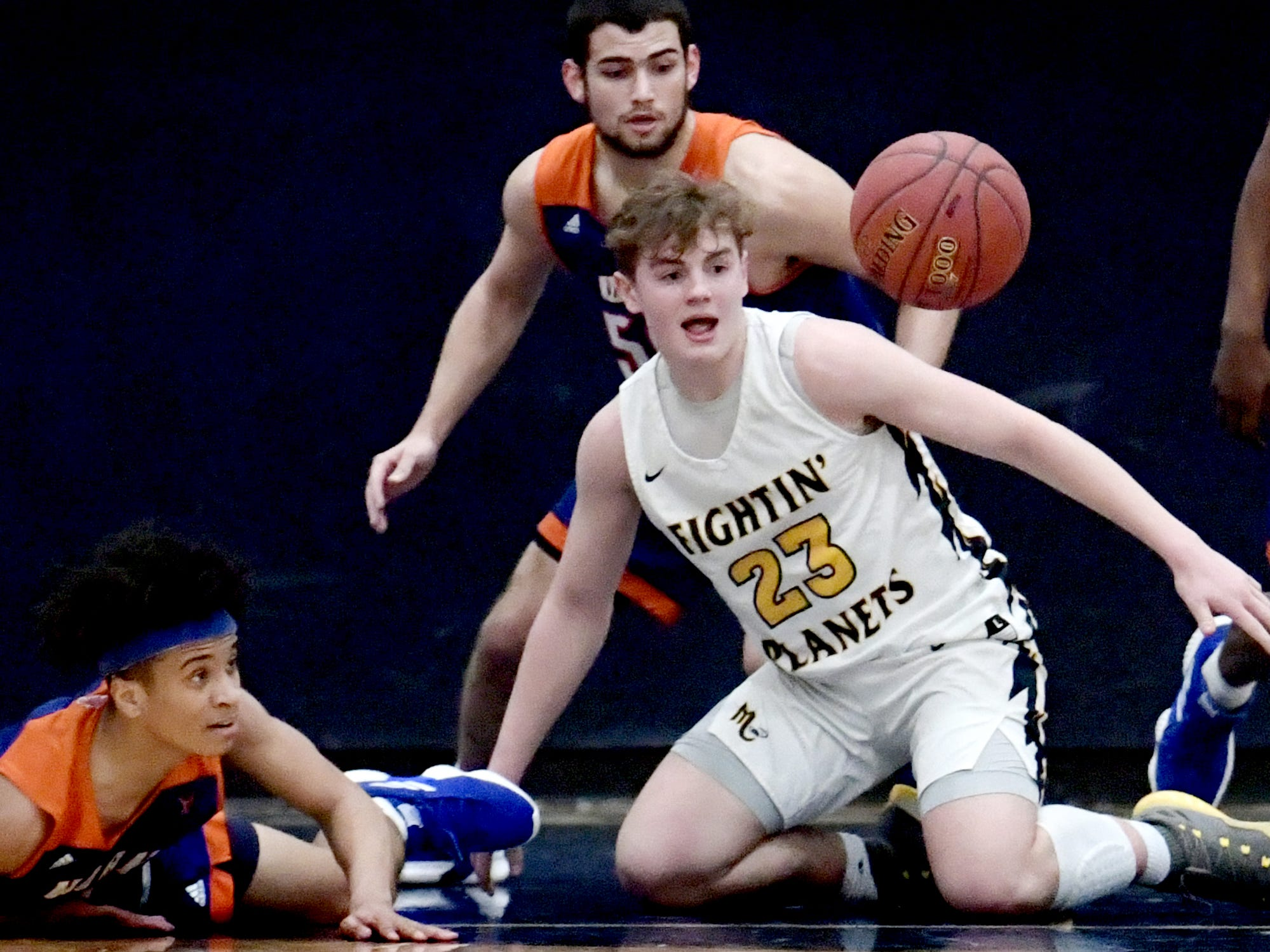York High's Jaevon Woodyard, left, Seth Bernstein and Mars' Brandon Caruso battle for a loose ball during a PIAA Class 5-A second-round state boys' basketball playoff game at Holidaysburg High School in Blair County Tuesday, March 12, 2019. York lost 60-59. Bill Kalina photo