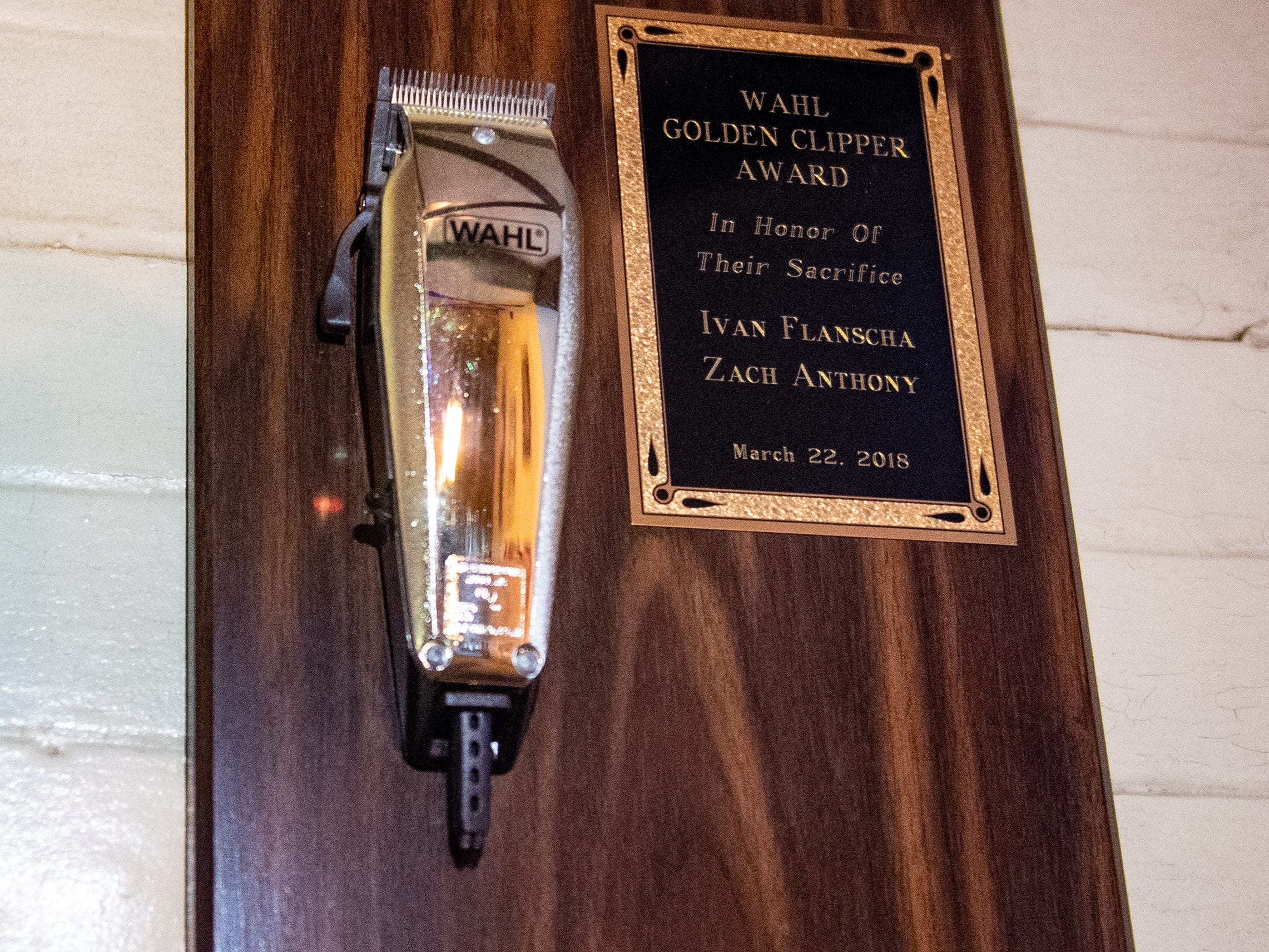 The Wahl Golden Clipper Award dedicated to Ivan Flanscha and Zachary Anthony sits in the lounge between the two oil paintings of the late York City firefighters, March 12, 2019.