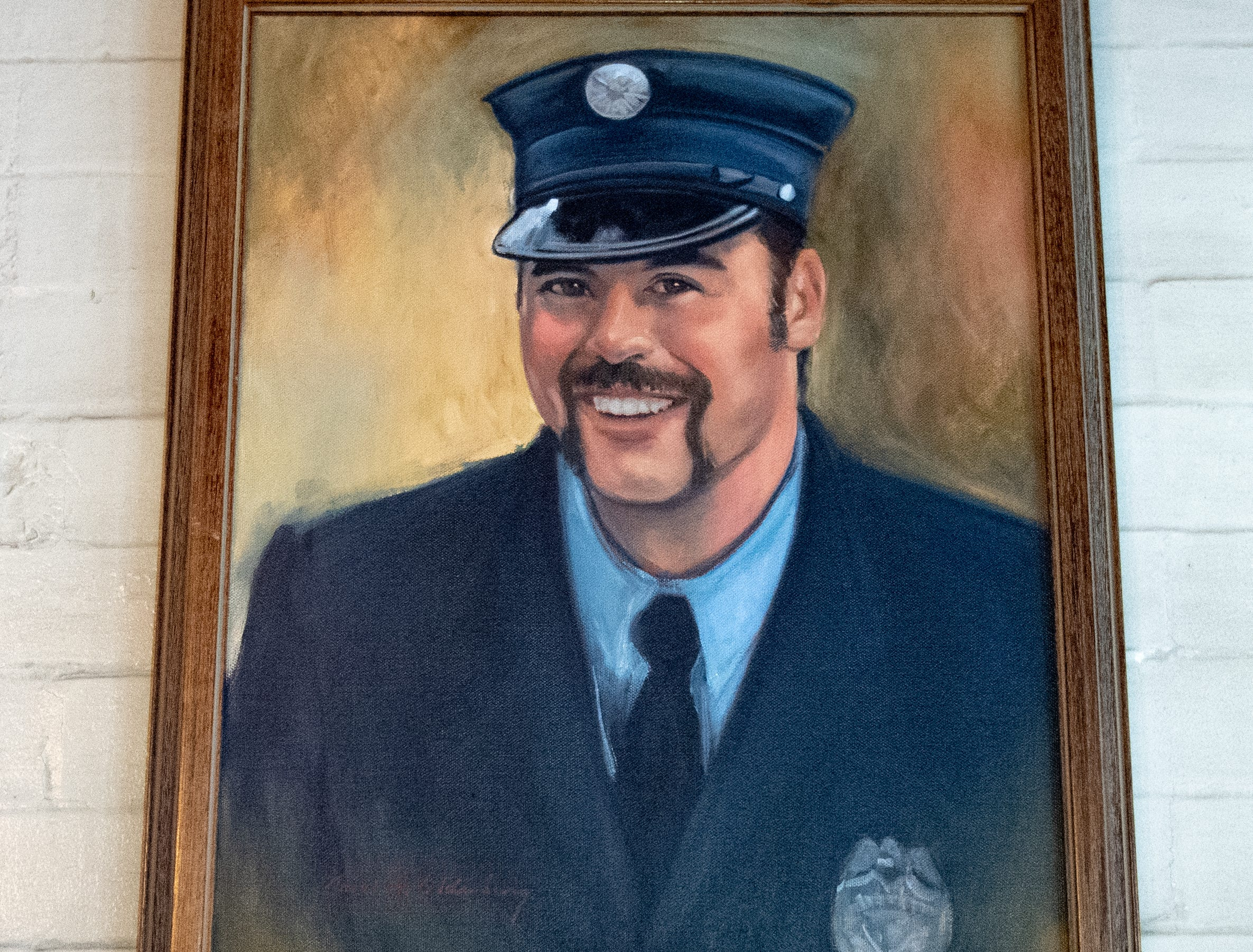 An oil painting of York City firefighter Zachary Anthony hangs to the right of Ivan Flanscha's in at the Laurel-Rex Fire Station lounge.