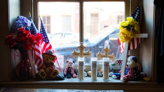 On a window sill in the Laurel-Rex Fire Station, sits a shrine to the department's fallen firefighters.