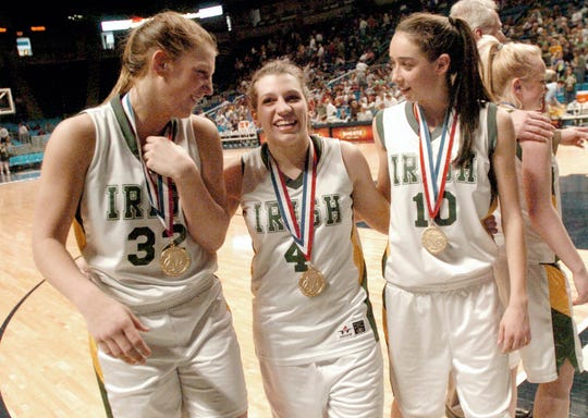 York Catholic players Kelly Rhein, Ashton Bankos and Kady Schrann walk off the floor after winning a state championship during the 2007-08 season. The 2008 Irish team had their 61-game winning streak snapped during the season but recovered to win the state title and finish the year with a 34-1 record.