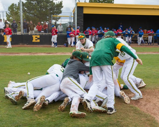 The Bishop Manogue team dog piles as they celebrate their win over Reno in the NIAA 4A Northern Regional Baseball Championship on May 12, 2018.