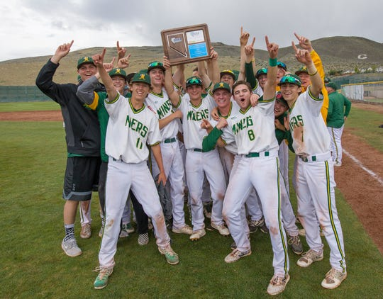 The Bishop Manogue team celebrates its win over Reno in the NIAA 4A Northern Regional Baseball Championship at Galena on May 12.