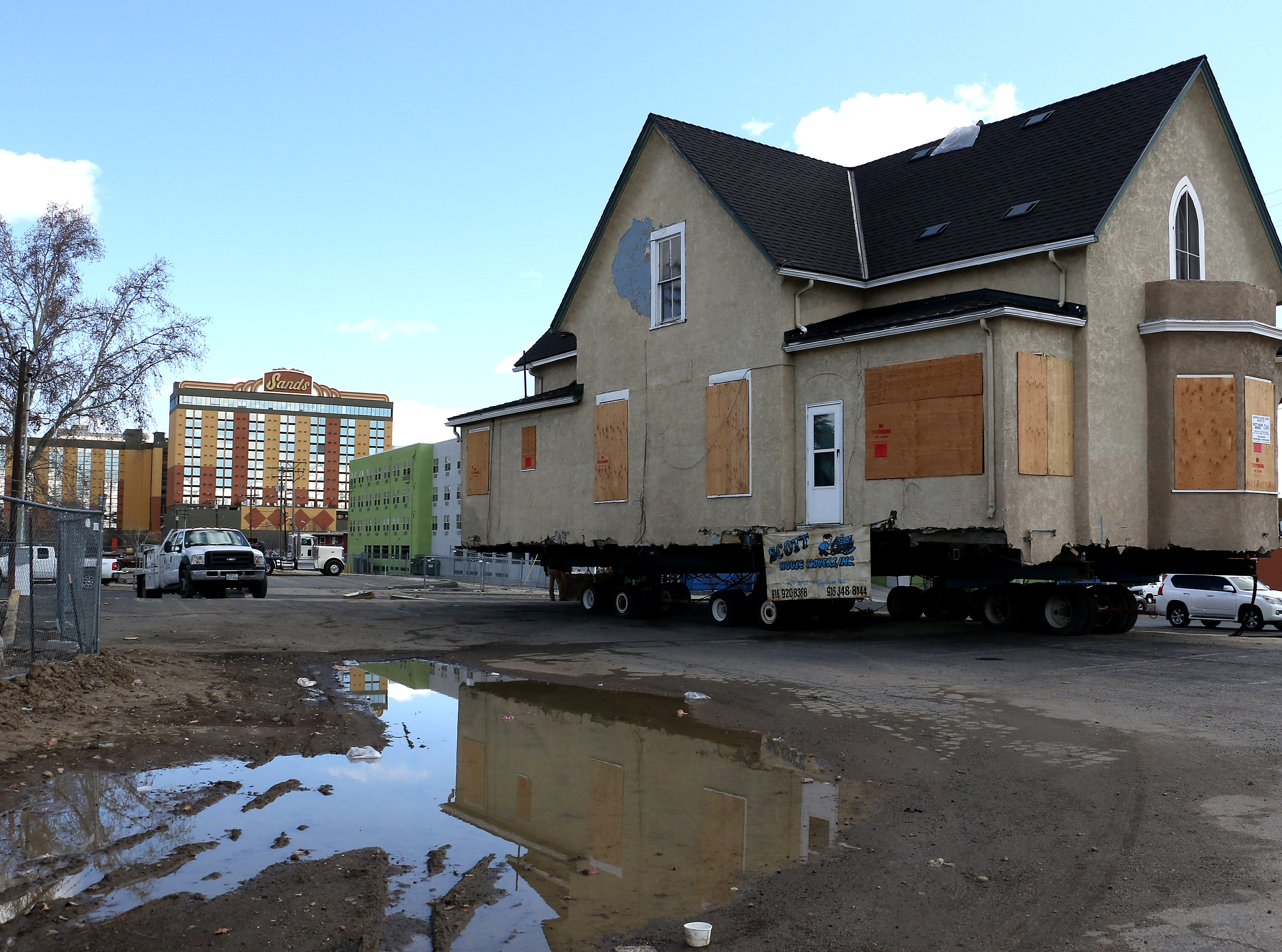 The historic Nystrom Guest House gets moved by Scott House Movers to its new location in downtown Reno on March 13, 2019. The house, which was added to the National Register of Historic Places in 2001, is being moved by Jacobs Entertainment from its current location at 333 Ralston St. to a plot on the 700 block of West Fourth Street.