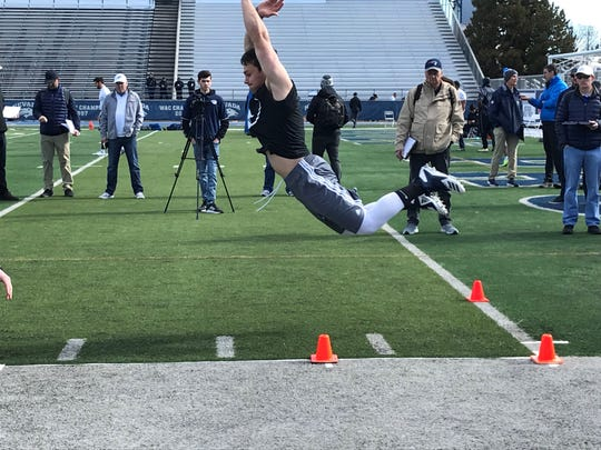 Wes Farnsworth does the broad jump on Wednesday at Mackay Stadium.