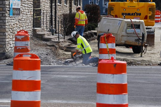 A Milestone Contractors crew works Wednesday on the bike path project on South 10th Street in Richmond.