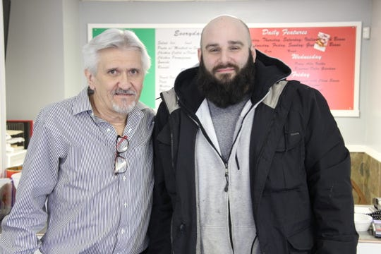 Joe Grygrowych, left, of Greece with Al Giardino at Fresco Italian Kitchen on Stone Road. The restaurant, owned by Giardino, is organizing a fundraiser in memory of Grygrowych's son Shane, who died of an opioid overdose in March 2018.