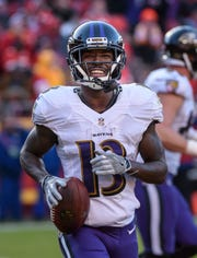 Baltimore Ravens wide receiver John Brown (13) celebrates after scoring a touchdown during a Dec. 9 game against the Kansas City Chiefs. Brown is expected to join the Buffalo Bills as a free agent.