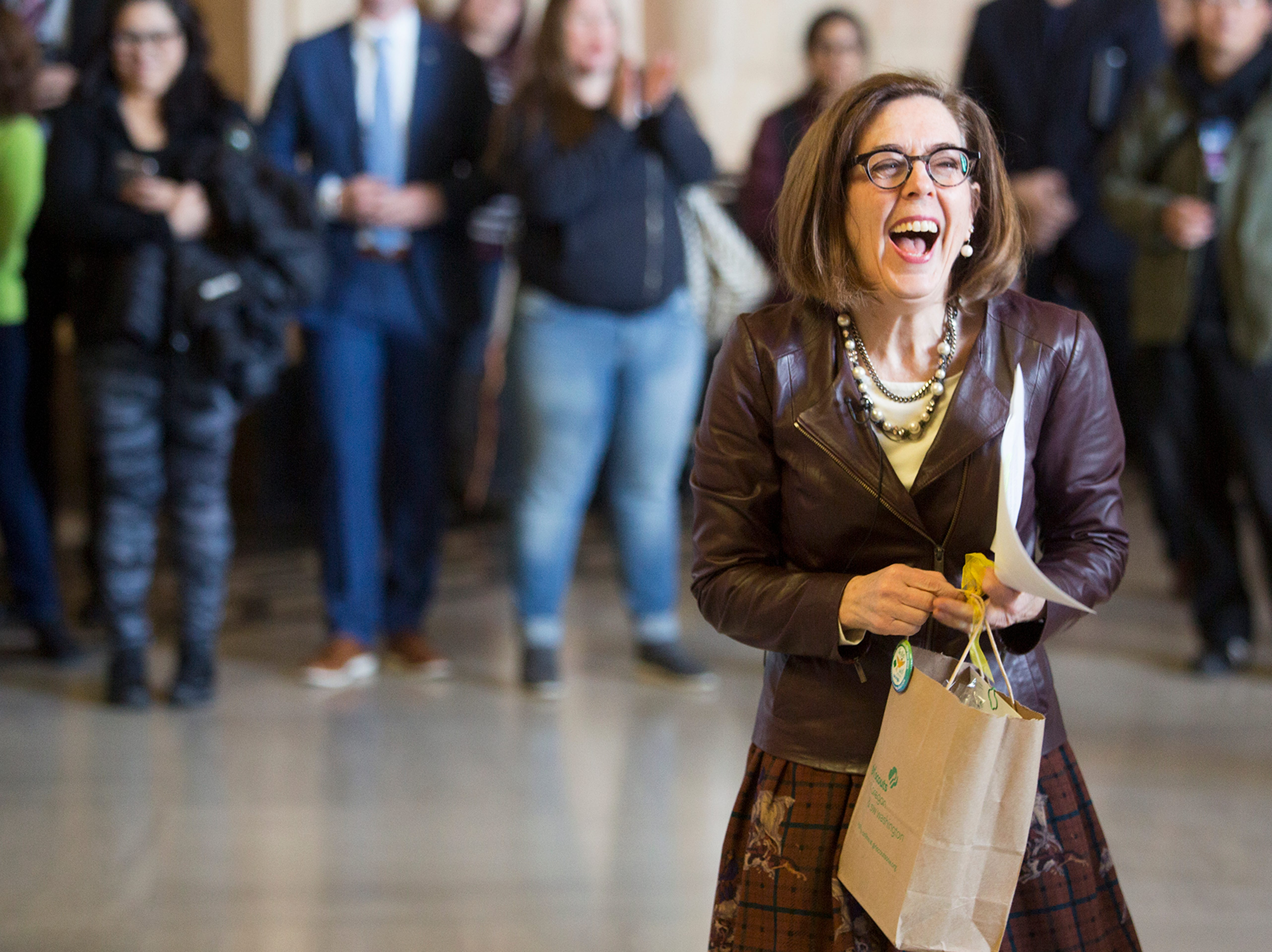 Gov. Kate Brown is gifted Girl Scout cookies during Girl Scout Leadership Day at the Oregon State Capitol in Salem March 12, 2019.
